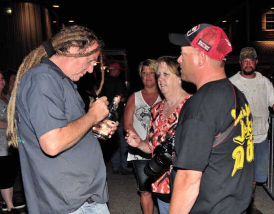 Full Throttle S'Loonshine Distillery owner Michael Ballard greets fans